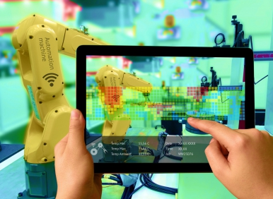 Yellow robot arm and man holding a tablet