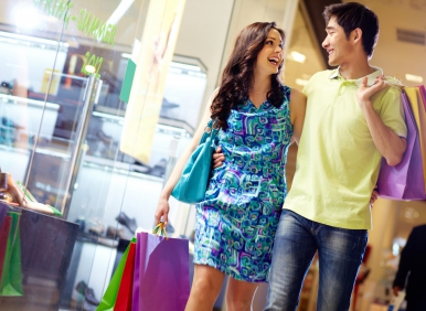 Asian Man And Woman Shopping
