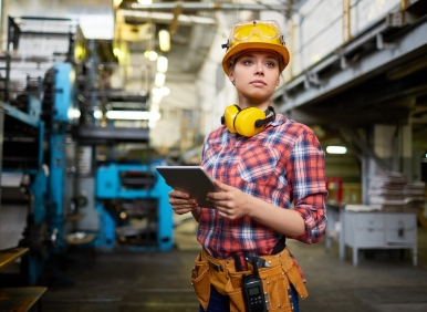Woman in hard hat in a factory