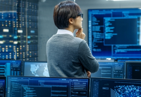 Man Thinking In Front Of Computers