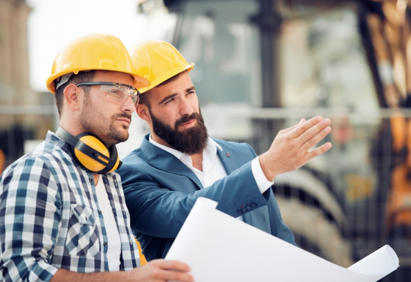 Two business men in hard hats