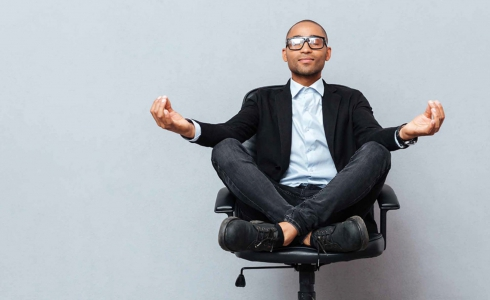 Man On An Office Chair Meditating