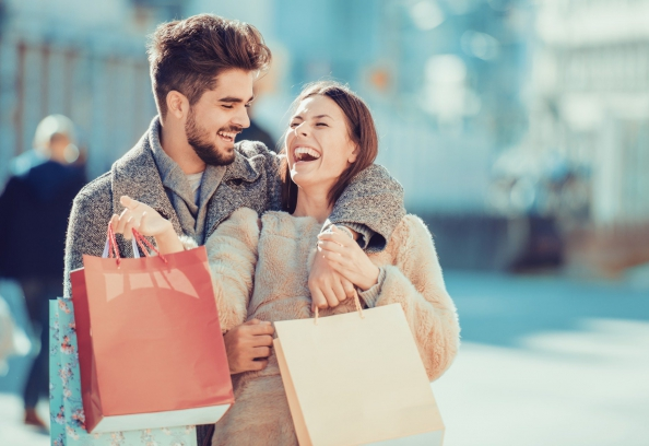 Couple Shopping And Smiling