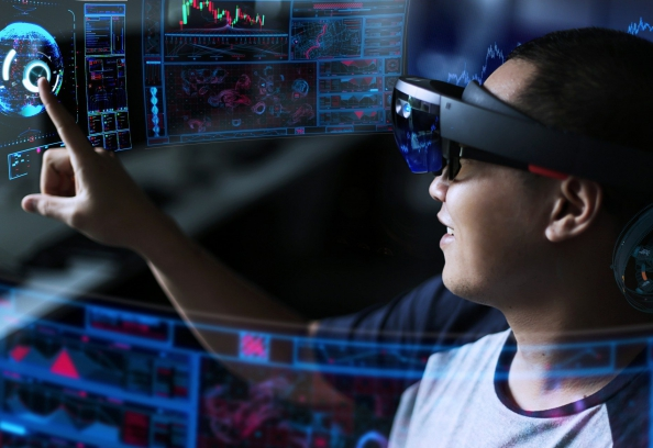 man looking at computer with hololens