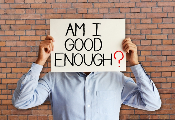 """Young businessman asking """"am I good enough"""""""