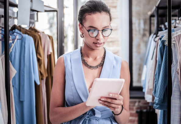 Woman In Retail Shop With Tablet
