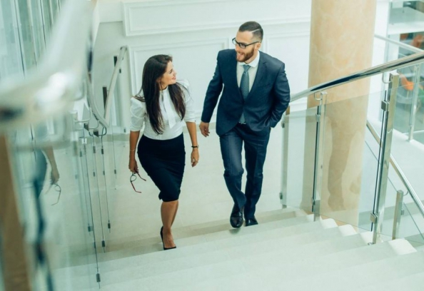 Business People Walking Up The Stairs