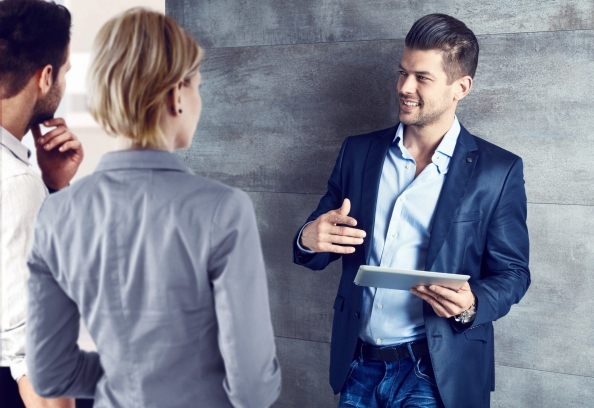 Business people talking at office using tablet