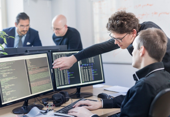 Young AI Programmers And IT Software Developers Team Brainstorming