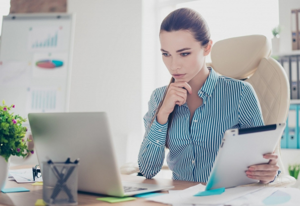 Business Woman Thinking In Front Of Computer