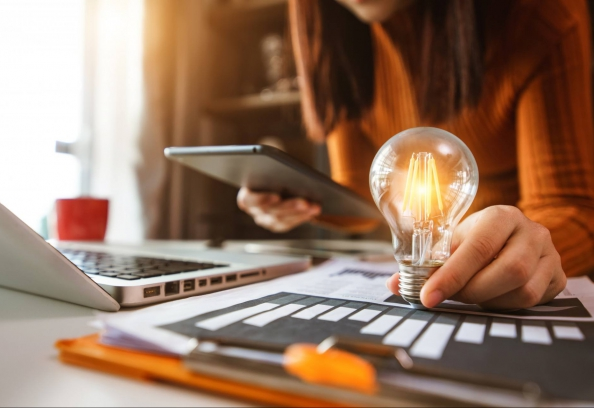 Woman Using Smartphone, Tablet And Holding Light Bulb, With Idea With Innovation And Creativity