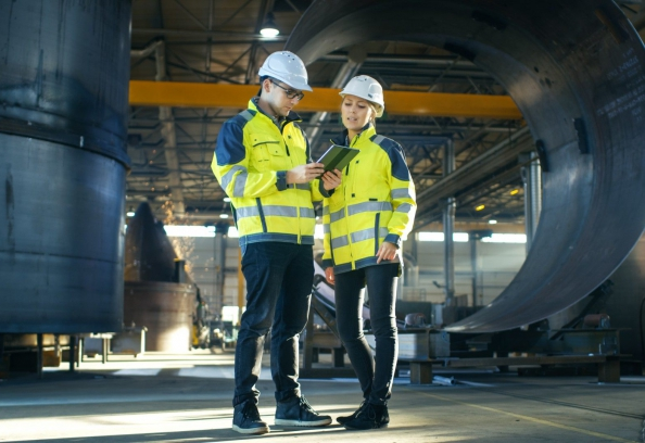 Male and Female Industrial Engineers in Hard Hats