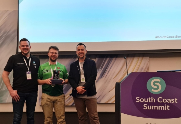 HSO's Larry Merkelis receiving his award as part of the winning team at the 'Automate Everything' Hackathon.
